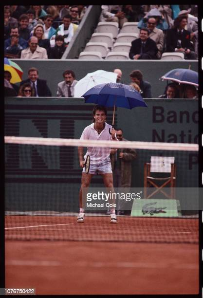 Andre Agassi Holding an Umbrella White Playing Tennis