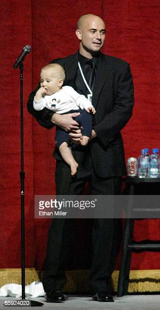 Andre Agassi holds his 11monthold son Jaden Agassi as the tennis star speaks at an auction during Andre Agassi's Grand Slam for Children benefit...