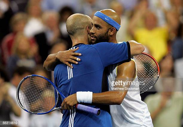 Andre Agassi is congratulated by Jame Blake after Agassi won their quarterfinal match during the US Open at the USTA National Tennis Center in...