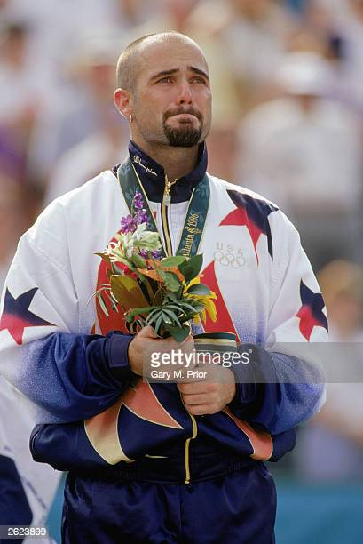 Andre Agassi is full with emotion as he stands as the men's tennis singles gold medal winner during the XXVI Olympic Games at the Stone Mountain...