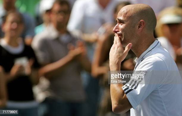 Andre Agassi is overcome with tears after being defeated by Benjamin Becker of Germany in his last career match at the U.S. Open at the USTA Billie...