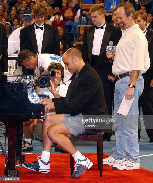 Andre Agassi NARAS's Michael Greene during MercedesBenz Cup 'Night at the Net' ProAm Celebrity Match at Stadium Court UCLA in Los Angeles California...