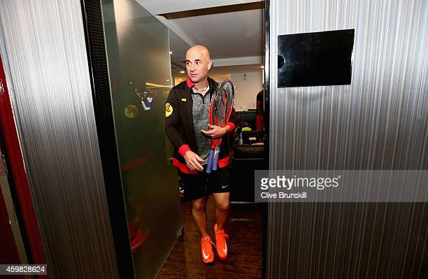 Andre Agassi of the Singapore Slammers leaves the team locker room for his match against Mark Philippoussis of the Manila Mavericks during the...