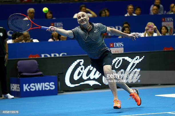 Andre Agassi of the Singapore Slammers plays a forehand in his match against Mark Philippoussis of the Manila Mavericks during the CocaCola...