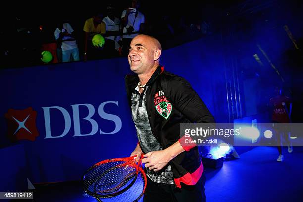 Andre Agassi of the Singapore Slammers runs out on to court to play his match against Mark Philippoussis of the Manila Mavericks during the Coca-Cola...