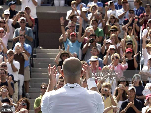 Andre Agassi of the United States acknowledges the crowd after losing his third round match to Benjamin Becker of Germany and retiring from tennis at...
