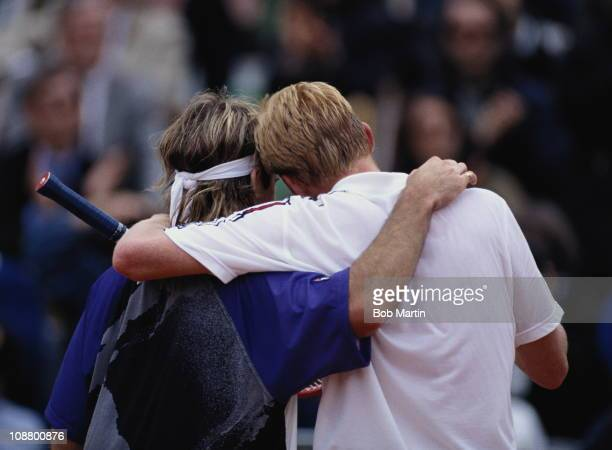 Andre Agassi of the United States and Boris Becker of Germany embrace each other after their Men's Singles semi final match during the French Open...