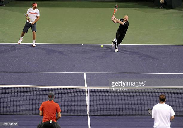 Andre Agassi of the United States and Rafael Nadal of Spain return serve against Pete Sampras of the United States and Roger Federer of Switzerland...