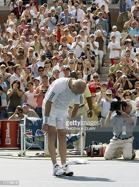 Andre Agassi of the United States bows after losing his third round match to Benjamin Becker of Germany and retiring from tennis at the 2006 US Open...