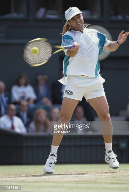 Andre Agassi of the United States during his Men's Singles quarter final match against Pete Sampras at the Wimbledon Lawn Tennis Championships on...