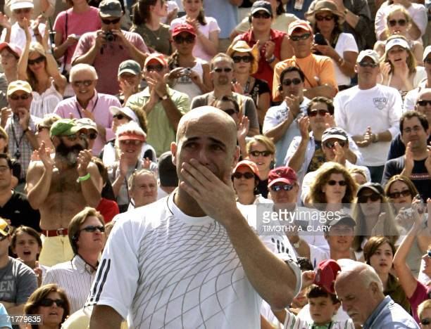Andre Agassi of the United States gestures after losing his match to Benjamin Becker of Germany and retiring from tennis at the 2006 US Open at the...