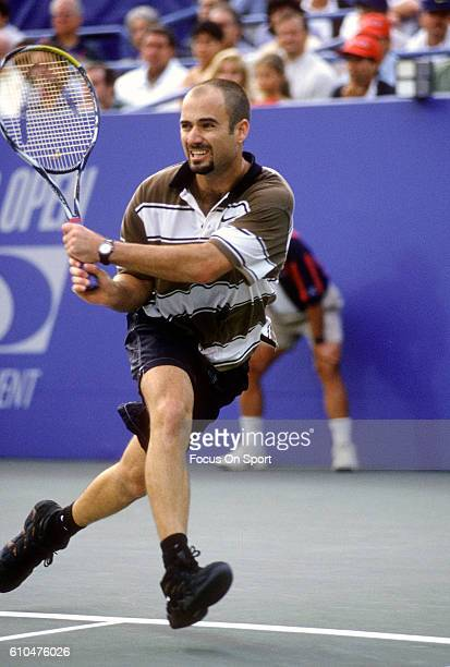 Andre Agassi of the United States hits a return during the Men's 1995 US Open Tennis Championships circa 1995 at the USTA Tennis Center in the Queens...