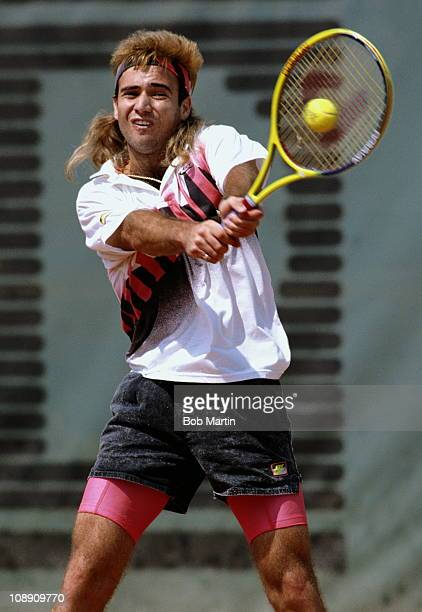 Andre Agassi of the United States makes a double hand return against Andres Gomez during the Men's Singles final match during the French Open Tennis...