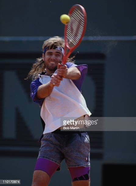 Andre Agassi of the United States makes a double hand return against Patrick McEnroe during their Men's Singles third round match at the French Open...