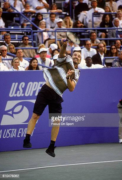 Andre Agassi of the United States serves during the Men's 1995 US Open Tennis Championships circa 1995 at the USTA Tennis Center in the Queens...