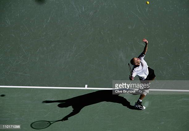 Andre Agassi of the United States serves to Gaston Etlis during their 5 set Men's Singles match on 18th January 1996 at the Australian Open Tennis...