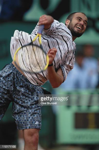 Andre Agassi of the United States serves to Yevgeny Kafelnikov during the Men's Singles quarter final match at the French Open Tennis Championship on...