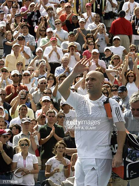 Andre Agassi of the United States waves to the crowd as he leaves the court after losing his third round match to Benjamin Becker of Germany and...