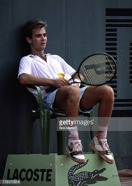 Andre Agassi of the United States wearing his jean style shorts sits down to take a break during a Men's Singles match against Massimiliano Narducci...