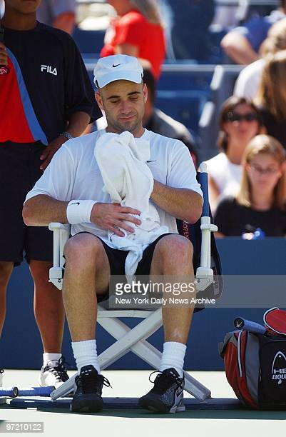 Andre Agassi of the US appears glum as he rests courtside during semifinal match against Juan Carlos Ferrero of Spain at the US Open in Flushing...