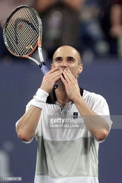 Andre Agassi of the US blows a kiss to the crowd after defeating Nicolas Escude of France in their quarterfinal match 08 September 1999 at the US...