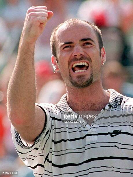 Andre Agassi of the US celebrates after winning his semifinal match against Sweden's Magnus Larsson of Sweden at The Lipton Championships tennis...