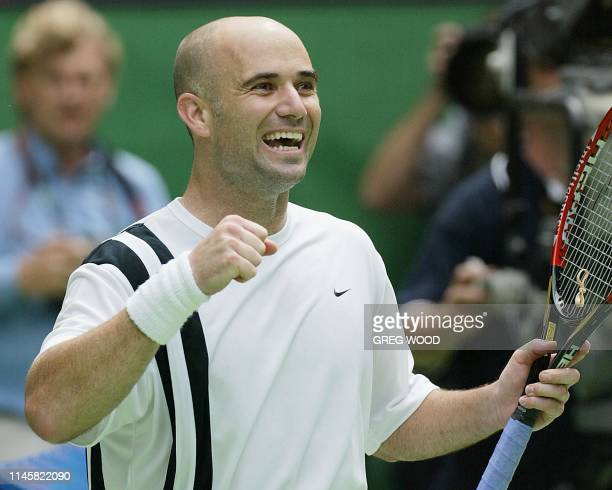 Andre Agassi of the US celebrates his victory over Rainer Schuettler of Germany in their men's singles final at the Australian Open tennis tournament...