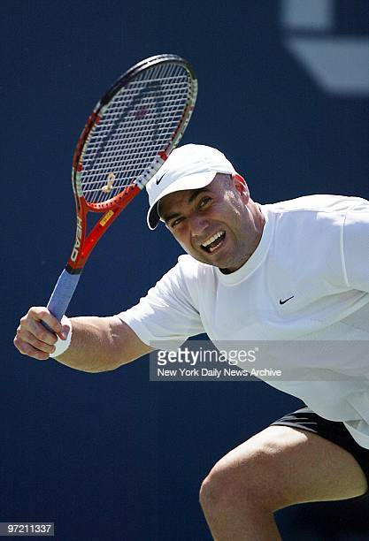 Andre Agassi of the US fires the ball to Guillermo Coria of Argentina during first set of quarterfinal match at the US Open in Flushing MeadowsCorona...