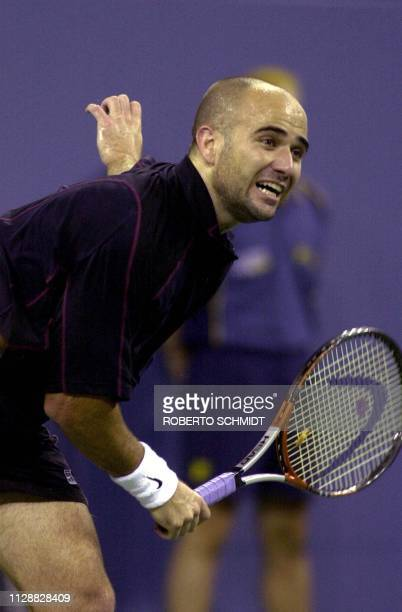 Andre Agassi of the US follows through on his serve against fellow countryman Alex Kim during his first round Men's singles match in the US Open...