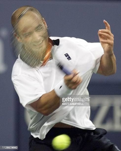 Andre Agassi of the US hits a forehand during his quaterfinal match against Nicolas Escude of France 08 September at the US Open in Flushing Meadows...