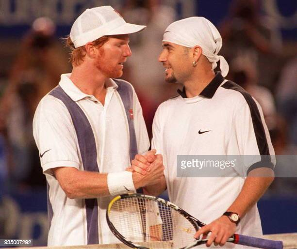 Andre Agassi of the US is congratulated by compatriot Jim Courier after their quarter finals match at the Australian Open in Melbourne 24 January...