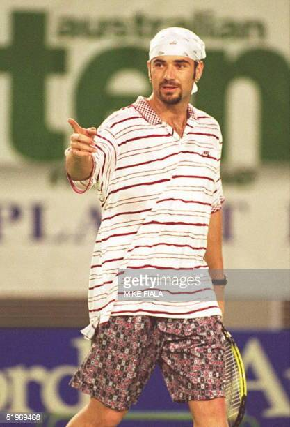 Andre Agassi of the US models his new look during a warmup match against Todd Martin of the US at the Australian Open in Melbourne 15 January Agassi...