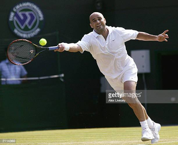 Andre Agassi of the US plays a forehand against Lars Burgsmuller of Germany during day four of the Wimbledon Tennis Championships at the All England...