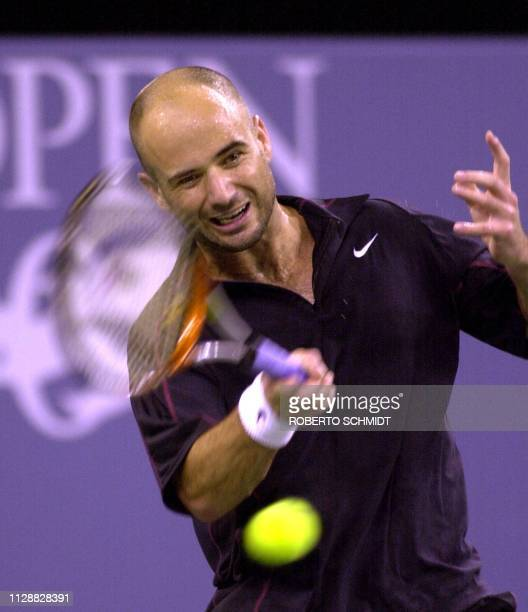 Andre Agassi of the US returns a forehand during his first round Men's singles match against Alex Kim of the US in the US Open tennis tournament in...