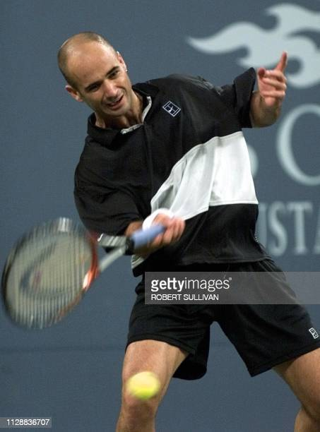 Andre Agassi of the US returns a shot to Nicklas Kulti of Sweeden 30 August 1999 during their opening round match at the 1999 US Open in Flushing...