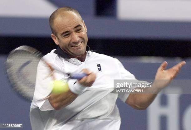 Andre Agassi of the US returns a shot to Nicolas Escude of France during their quaterfinal match 08 September at the US Open in Flushing Meadows AFP...