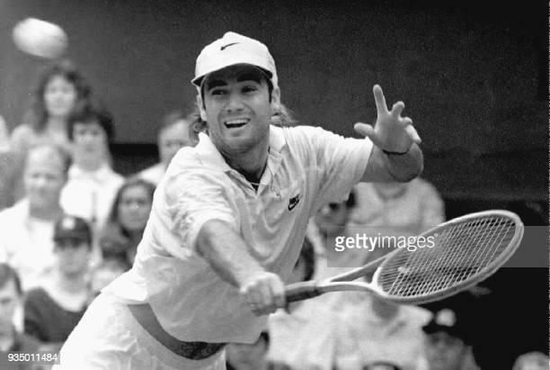 Andre Agassi of the US returns the ball to Germany's Boris Becker at the Wimbledon Tennis Championships 01 July 1992 Wimbledon England The match was...