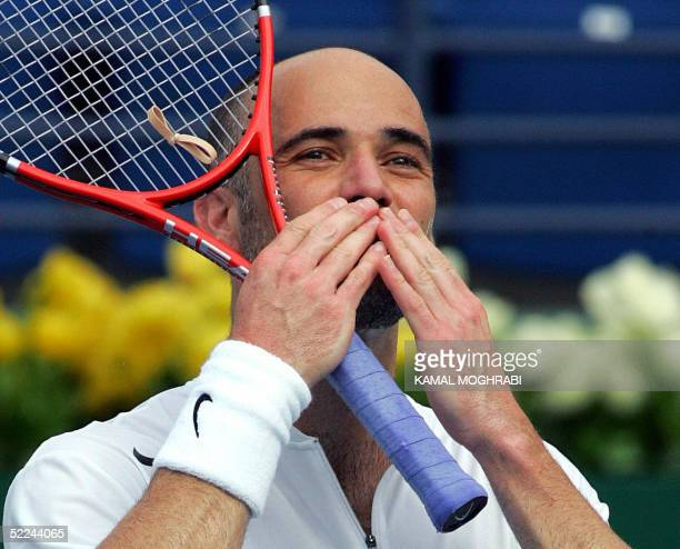 Andre Agassi of the US sends a kiss to the crowds after he won the match against Russia's Nikolay Davydenko during their quarter-final ATP Tennis...