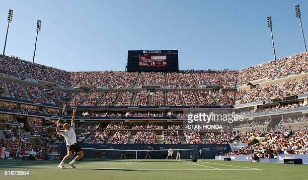Andre Agassi of the US serves to Pete Sampras of the US during their men's singles final match at the US Open Tennis Tournament 08 September 2002 at...