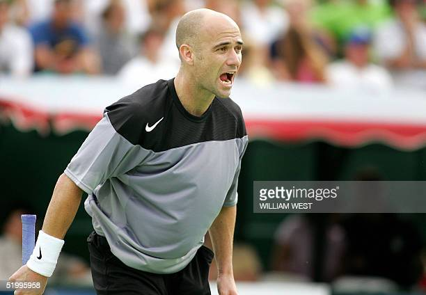 Andre Agassi of the US yells out in frustration during his loss to Great Britain's Tim Henman in the playoff for third and fourth in the Kooyong...