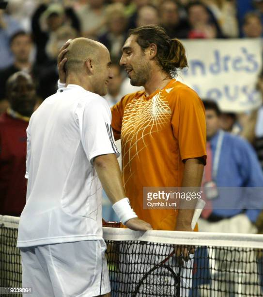 Andre Agassi of the USA and Marcos Baghdatis of Cyprus at the net after Agassi defeated Baghdatis 64 64 36 57 75 in the second round of the US Open...