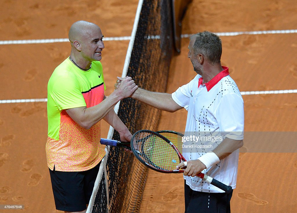 Andre Agassi (L) of the USA and Thomas Muster of Austria shake hands during their Berenberg Classic match against on day one of the Porsche Tennis Grand Prix at Porsche-Arena on April 20, 2015 in Stuttgart, Germany.