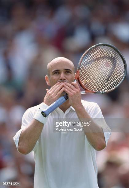 Andre Agassi of the USA blowing a kiss to the crowd during the Wimbledon Lawn Tennis Championships at the All England Lawn Tennis and Croquet Club...
