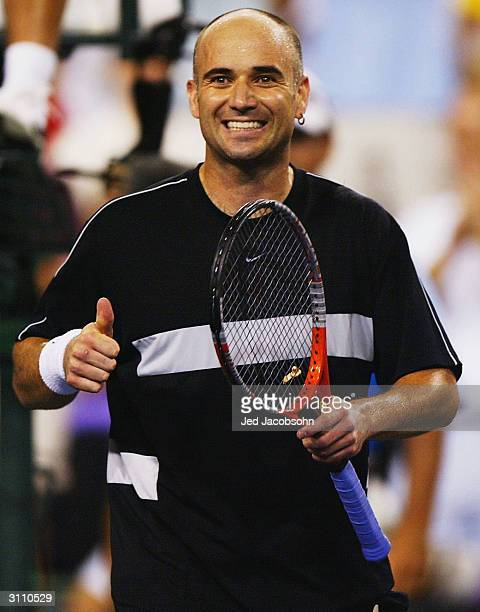Andre Agassi of the USA celebrates after defeating Guillermo Coria of Argentina at the Pacific Life Open on March 18, 2004 at the Indian Wells Tennis...