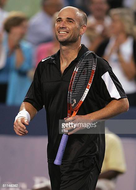 Andre Agassi of the USA celebrates his win over Juan Ignacio Chela of Argentina during the Western and Southern Financial Group Masters on August 5...