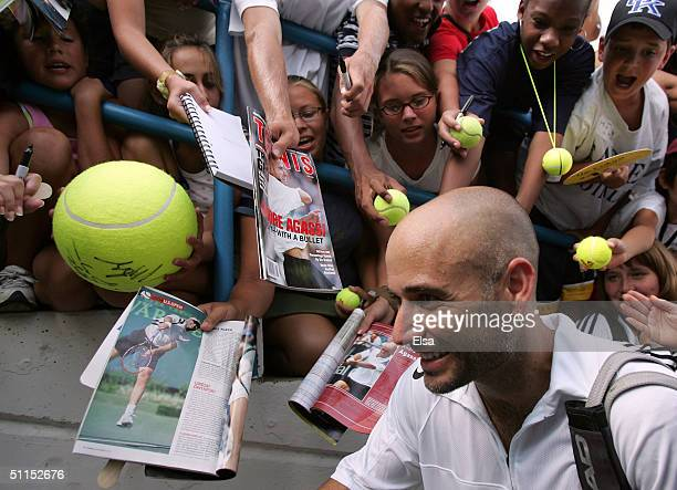 Andre Agassi of the USA heads off the court after he defeated Lleyton Hewitt of Australia in the championship match during the Western and Southern...