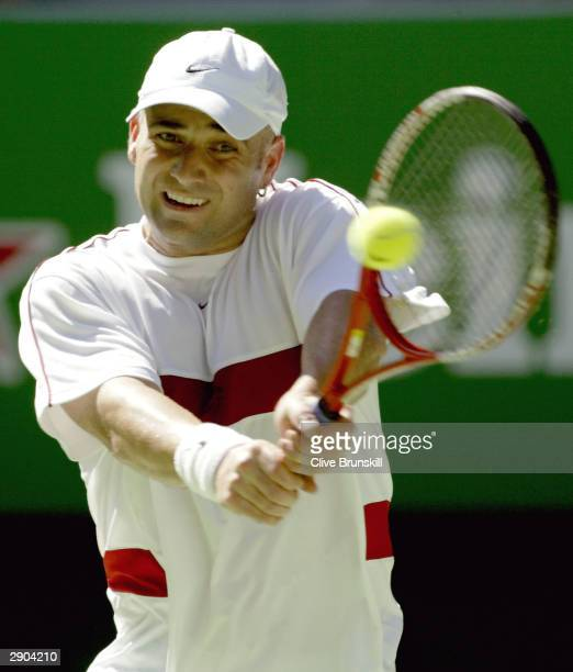 Andre Agassi of the USA hits a backhand against Sebastien Grosjean of France during day nine of the Australian Open Grand Slam at Melbourne Park...