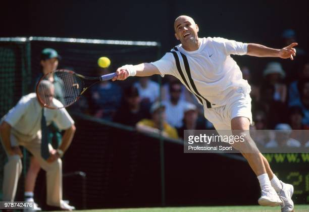 Andre Agassi of the USA in action during the Wimbledon Lawn Tennis Championships at the All England Lawn Tennis and Croquet Club circa June 2003 in...