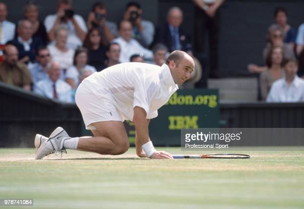Andre Agassi of the USA on the ground after falling during the Wimbledon Lawn Tennis Championships at the All England Lawn Tennis and Croquet Club...