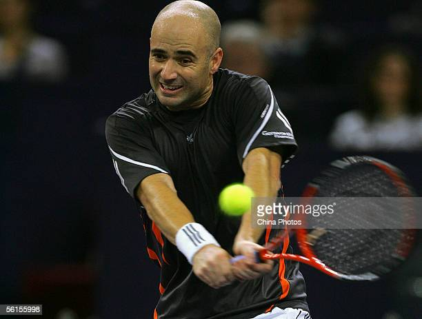 Andre Agassi of the USA plays a backhand during his straight sets defeat against Nikolay Davydenko of Russia in his first match of the round robin at...